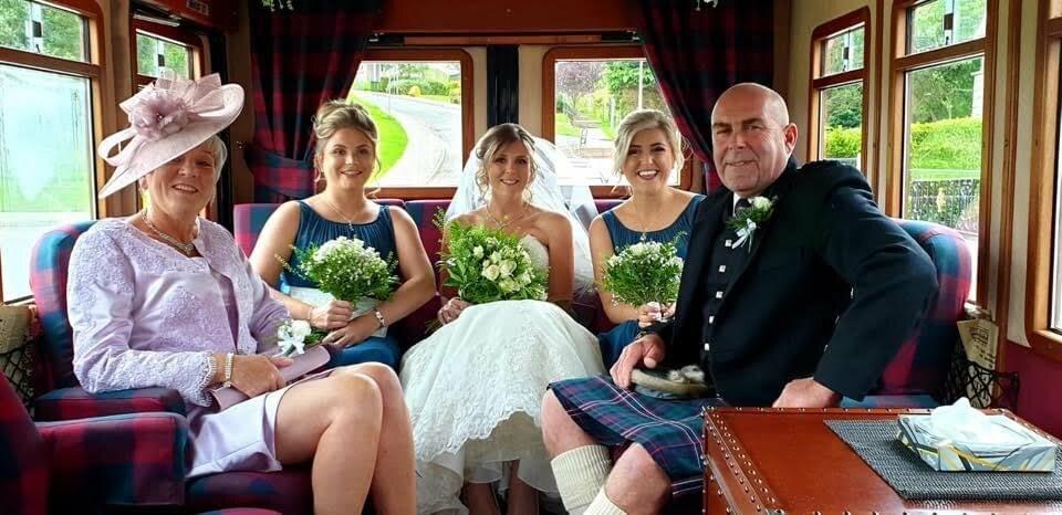 Wedding party sat inside Henry
